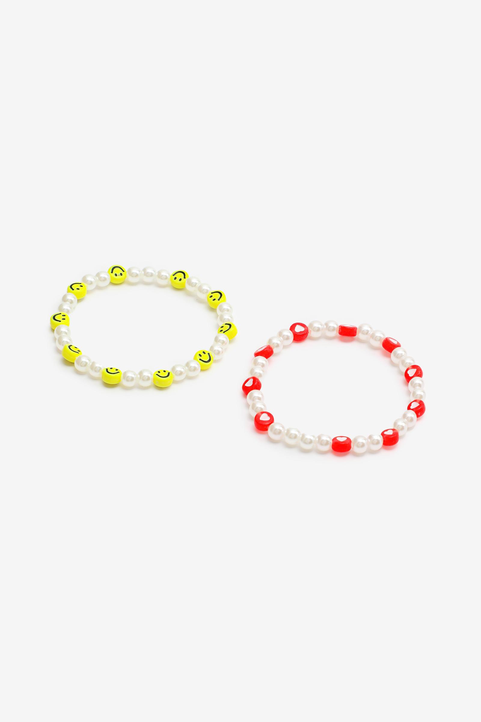 Duo de bracelets coeurs et bonhommes sourires