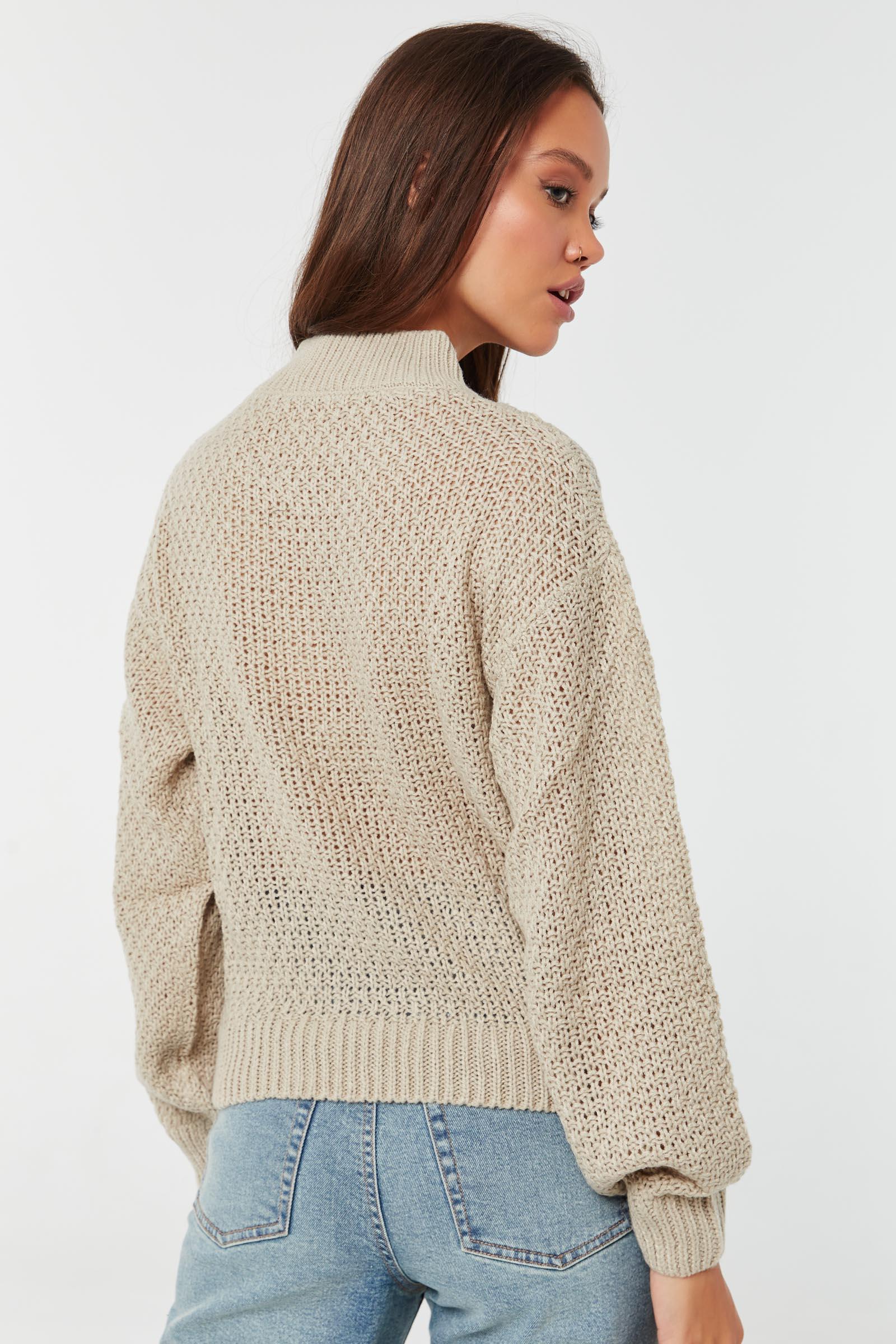 Pull en tricot torsadé à manches bouffantes