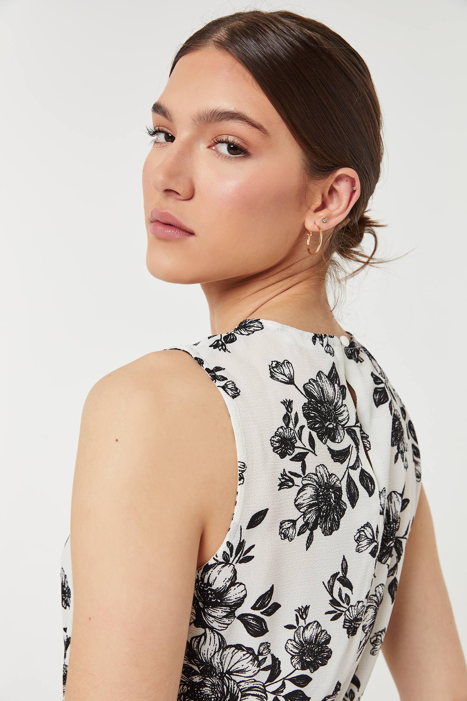 Floral Sleeveless Peplum Top
